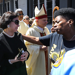 A Saints fan comes up to offer condolences to New Orleans Saints owner Gayle Benson at the funeral service for NFL New Orleans Saints owner and NBA New Orleans Pelicans owner Tom Benson in New Orleans, Friday, March 23, 2018. Benson died last Thursday at the age of 90. (AP Photo/Derick Hingle)