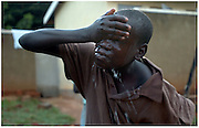 Bea Ahbeck/Fremont Argus<br /> <br /> Former child soldier Biken Okello, 17, washes his face in the early morning of October 29, 2005, at the GUSCO (Gulu Support the Children Organization) Child Soldier Rehabilitaion Center in Gulu, Northern Uganda. The children are taught the importance of hygiene and have daily routines at the camp. Joseph Kony's rebel army LRA (Lord's Resistance Army) have abducted over 20,000 children in the last 18 years of war and turned them into child soldiers, porters or sex slaves.