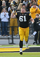 November 21, 2009: Iowa defensive tackle Travis Meade (61) is introduced as part of senior day before the Iowa Hawkeyes 12-0 win over the Minnesota Golden Gophers at Kinnick Stadium in Iowa City, Iowa on November 21, 2009.