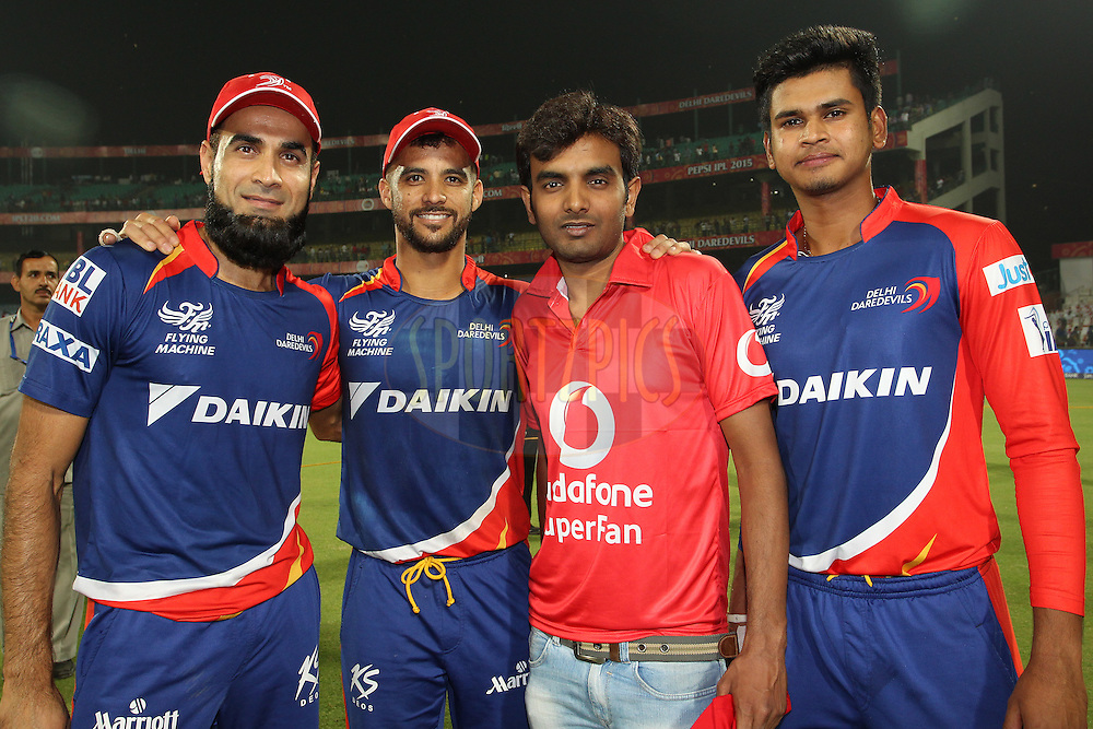 Imran Tahir of the Delhi Daredevils, Delhi Daredevils captain Jean-Paul Duminy, the Vodafone Superfan and Shreyas Iyer of the Delhi Daredevils during match 21 of the Pepsi IPL 2015 (Indian Premier League) between The Delhi Daredevils and The Mumbai Indians held at the Ferozeshah Kotla stadium in Delhi, India on the 23rd April 2015.<br /> <br /> Photo by:  Shaun Roy / SPORTZPICS / IPL