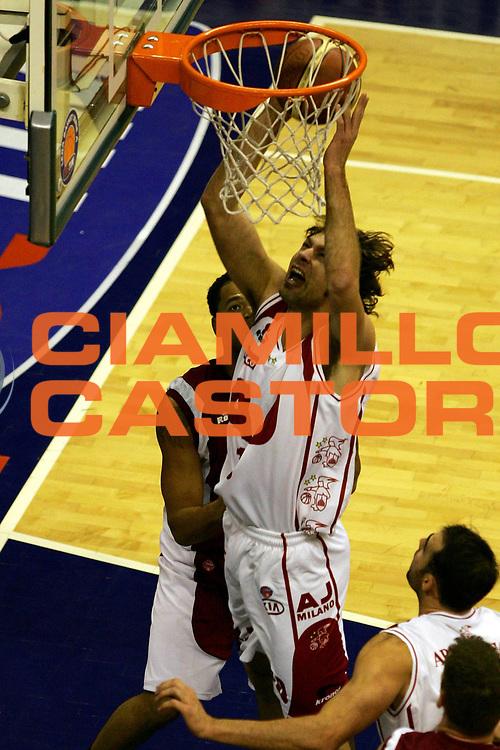 DESCRIZIONE : Milano Lega A1 2005-06 Armani Jeans Olimpia Milano Basket Livorno<br /> GIOCATORE : Galanda<br /> SQUADRA : Armani Jeans Olimpia Milano<br /> EVENTO : Campionato Lega A1 2005-2006<br /> GARA : Armani Jeans Olimpia Milano Basket Livorno<br /> DATA : 18/12/2005<br /> CATEGORIA : Tiro<br /> SPORT : Pallacanestro<br /> AUTORE : Agenzia Ciamillo-Castoria/L.Lussoso
