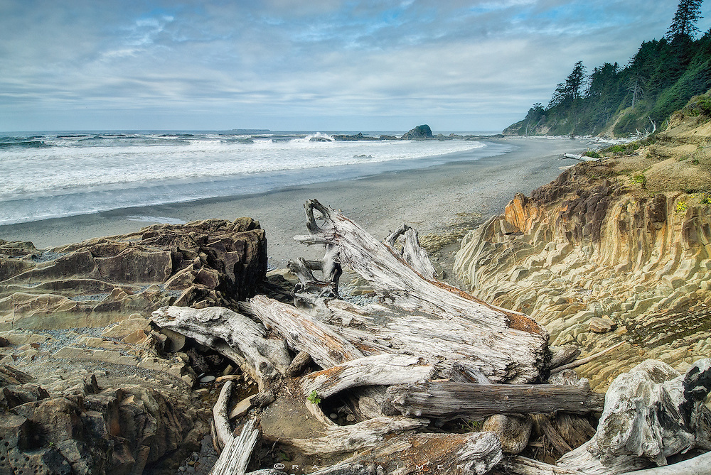 The Pacific is breaking against the rocks offshore in a tide of anger, against the beach in a froth of argument. She doesn't know what she wants.  I can relate to the driftwood under my feet.  Plastered against the shoreline, they are pieces of the coast, and, for now, I am just another.  Coastal. On a strip between what may as well be two planets. Cast out of her orbit like so much debris, wondering if she'll ever come in far enough again to lift us from this world to hers.  To ride her waves and feel the pull of her current.  To hear her quiet voice, so soft, like swells caressing timeless sand.  Small wonder that we are drawn to the ocean.  But she will turn on a whim, in dark deceit, and hurl us into a world of hurt.  Her depth is cold and heartless.  There are ruins as far as I can see, waiting for the next big storm.  I have learned not to trust.