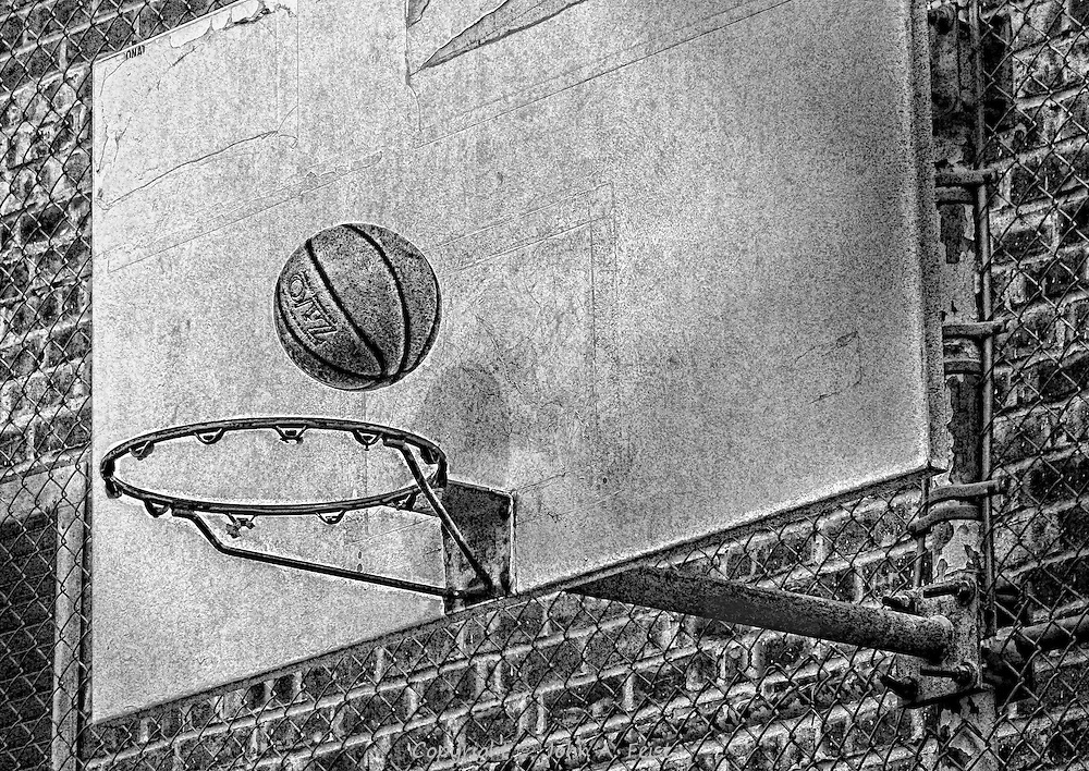 Classic New York, playing basketball on a hoop without nets. I was walking by when I saw a few kids playing and got this shot. I'll leave it up to you, did it go in?