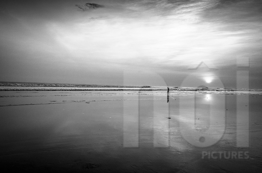 Lone silhouette on a beach of Sittwe, Rakhine State, Myanmar, Asia