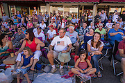 30 JUNE 2012 - PRESCOTT, AZ:   Spectators watch the Prescott Frontier Days Rodeo Parade. The parade is marking its 125th year. It is one of the largest 4th of July Parades in Arizona. Prescott, about 100 miles north of Phoenix, was the first territorial capital of Arizona.   PHOTO BY JACK KURTZ