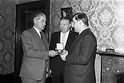 20/02/1964<br /> 02/20/1964<br /> 20 February 1964<br /> Presentation of World Wines and Liquor Olympics award to John Power and Son Ltd at the John's Lane Distillery. The prize was awarded for their Sarotov Vodka which received the Premier Award in its Category in the World Wines and Liquor Olympics.<br /> Picture shows M. andre L. de Vogelaere, Counsellor of the Belgian Embassy presenting the medal to Mr P.A. Leavy, Sales Manager John Power and Son Ltd.