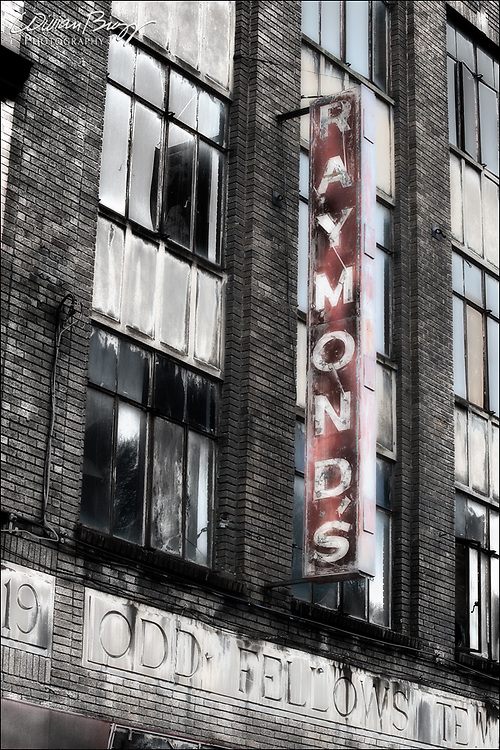 Raymond's.  An abandoned storefront.