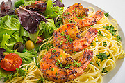 Grilled shrimp scampi over angel hair pasta