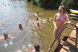 © licensed to London News Pictures. London, UK 01/08/2013. People enjoying hot weather at Hampstead Heath Park Mixed Bathing Pond in north London on Thursday, August 1, 2013. Photo credit: Tolga Akmen/LNP
