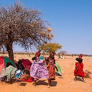 Himba tents and campsite at a funeral gathering, Kaokoland, Namibia