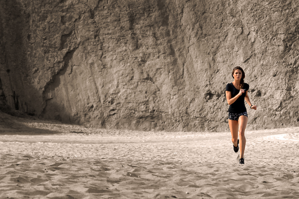 Female runner sprinting on sand at Point Dume in Malibu, CA - Fitness Photographer - Los Angeles Fitness Photographer - Los Angeles Fitness Photographers