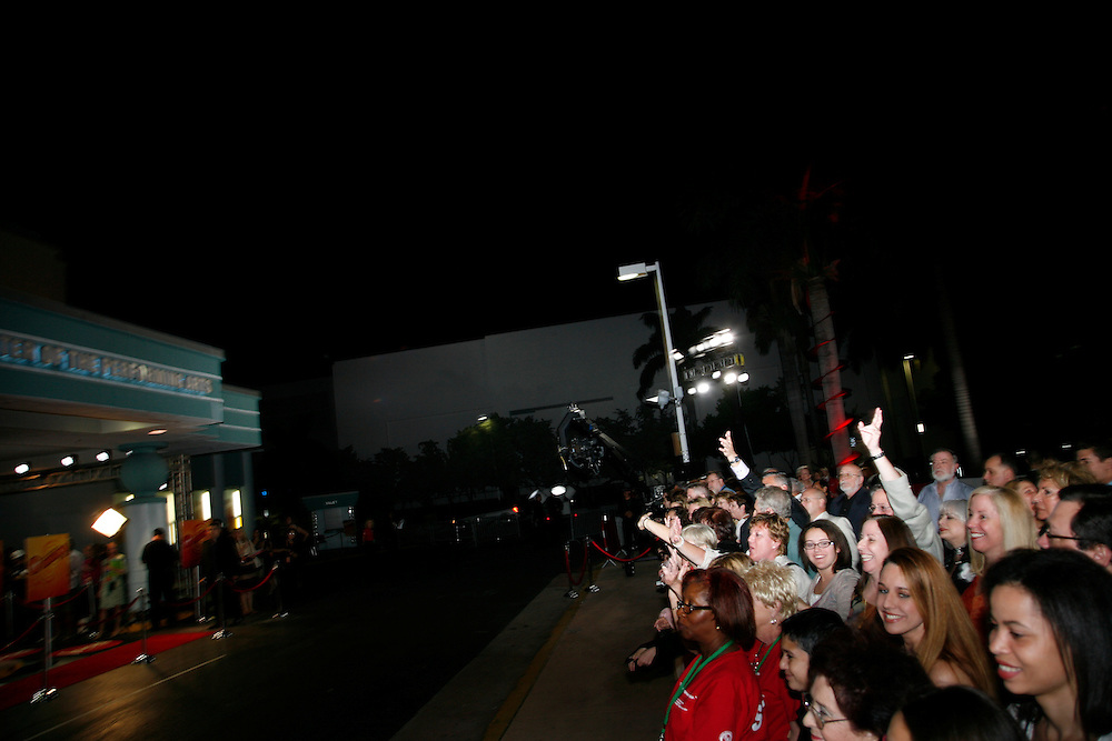 Foodies wave at a camera, while they wait for their favorite stars to arrive at the First Food Network Awards Show at the Jackie Gleason Theater  of the Performing Arts, in Miami, FL on  Feb 23, 2007.  (Photo/Lance Cheung) <br /> <br /> PHOTO COPYRIGHT 2007 LANCE CHEUNG<br /> This photograph is NOT within the public domain.<br /> This photograph is not to be downloaded, stored, manipulated, printed or distributed with out the written permission from the photographer. <br /> This photograph is protected under domestic and international laws.