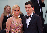 Actress Olivia Hamilton and director Damien Chazelle at the First Man Premiere, Opening Ceremony and Lifetime Achievement Award To Vanessa Redgrave at the 75th Venice Film Festival, Sala Grande on Wednesday 29th August 2018, Venice Lido, Italy.