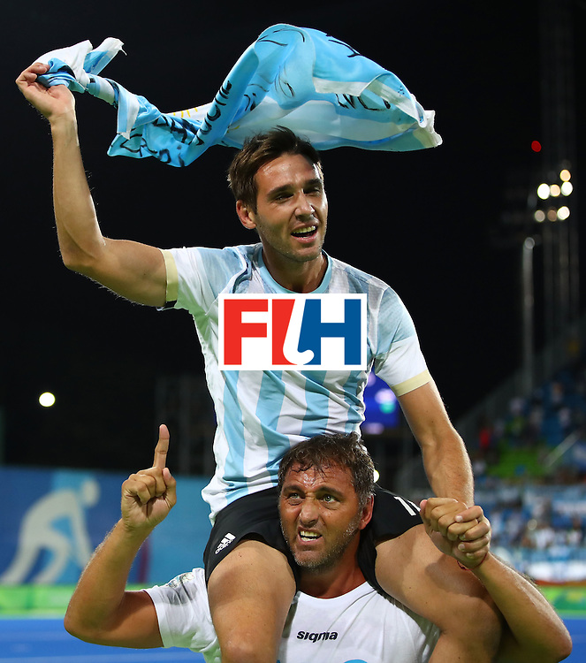 RIO DE JANEIRO, BRAZIL - AUGUST 18:  Matias Paredes #10 of Argentina celebrates winning the Men's Hockey Gold Medal match between Belgium and Argentina on Day 13 of the Rio 2016 Olympic Games at Olympic Hockey Centre on August 18, 2016 in Rio de Janeiro, Brazil.  (Photo by Clive Brunskill/Getty Images)