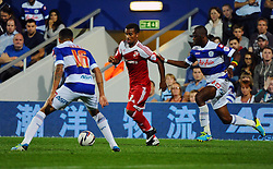 Swindon Town's Nathan Byrne looks to take on the QPR defence  - Photo mandatory by-line: Seb Daly/JMP - Tel: Mobile: 07966 386802 27/08/2013 - SPORT - FOOTBALL - Loftus Road - London - Queens Park Rangers V Swindon Town -  Capital One Cup - Round 2