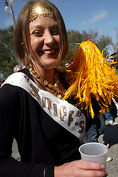 07 February 2010. New Orleans, Louisiana, USA. <br /> Sarah Roberts. The 'Barkus' parade sets off with Saints mania clearly the flavour of the day for New Orleans' only dog Mardi Gras parade. Saints fans gather in the French Quarter in anticipation of the big game in Miami later in the day as the home team goes head to head with the Indianapolis Colts for Superbowl 44. <br /> Photo ©; Charlie Varley/varleypix.com