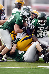 12 November 2011:  A pile of Titans and Vikings battle for the pigskin during an NCAA division 3 football game between the Augustana Vikings and the Illinois Wesleyan Titans in Tucci Stadium on Wilder Field, Bloomington IL