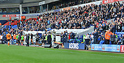 the bolton fans applaud their team at half time as they come in leading 2-0 during the Sky Bet Championship match between Bolton Wanderers and Wolverhampton Wanderers at the Macron Stadium, Bolton, England on 12 September 2015. Photo by Mark Pollitt.