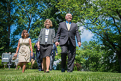 June 6, 2017 - Washington, DC, United States of America - Karen Pence, wife of Vice President Mike Pence, left, walks without shoes with U.S. Agriculture Secretary Sonny Perdue, right, and his wife Mary Ruff in the garden of the Vice Presidents residence June 6, 2017 in Washington, DC. Karen Pence, an avid bee keeper unveiled a bee hive on the grounds of the residence. (Credit Image: © Preston Keres/Planet Pix via ZUMA Wire)