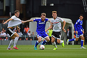 Cardiff City midfielder Aron Gunnarsson (17) holds off a challenge during the EFL Sky Bet Championship match between Fulham and Cardiff City at Craven Cottage, London, England on 20 August 2016. Photo by Jon Bromley.