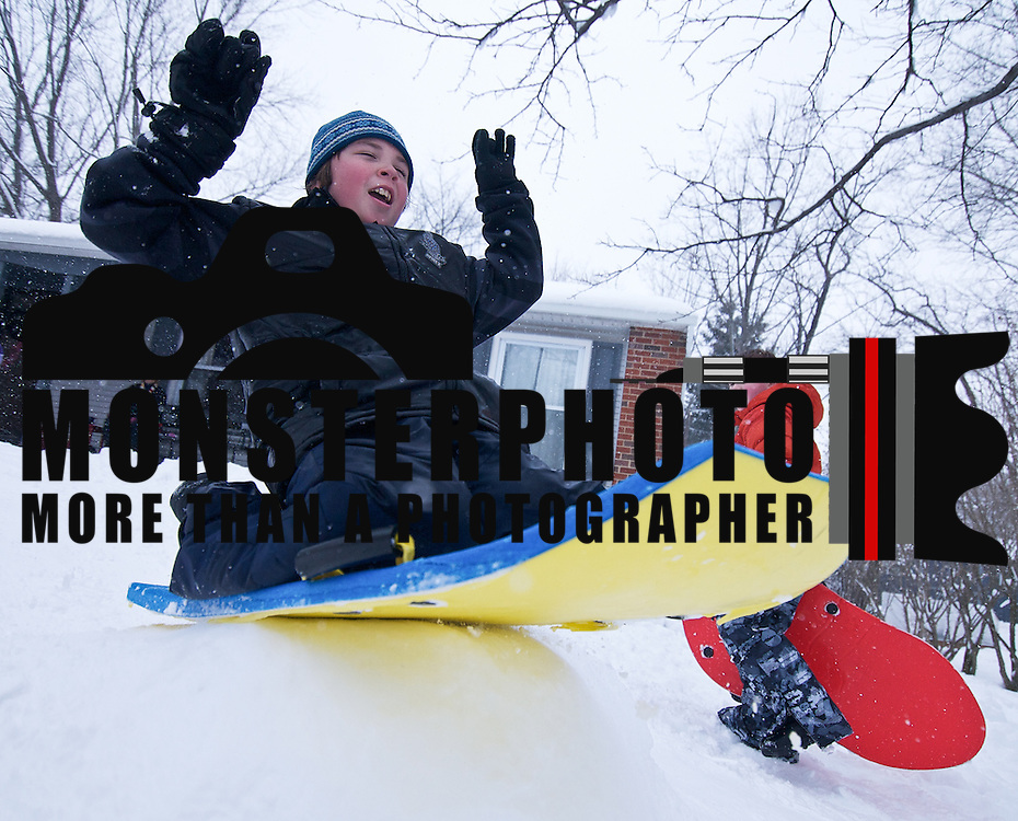 01'28/11 Wilmington DE: Ralph Wilkinson (9) in from the Tarleton neighborhood in Wilmington enjoy himself Friday afternoon sledding down the hill on the Wilkinson property ...Special to The News Journal/SAQUAN STIMPSON