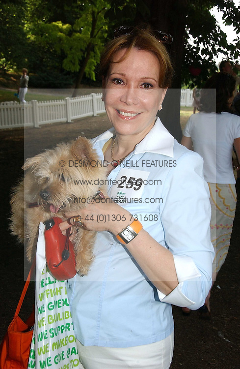 SYBIL KRETZMER and her dog at the Macmillan Cancer Support Dog Day held in the gardens of the Royal Hospital, Chelsea, London on 4th July 2006.<br />
