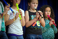 Hailey O keeps an eye on the rest of her recorder ensemble during the Borah Elementary talent show Tuesday, June 8, 2010.