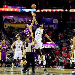 Nov 12, 2016; New Orleans, LA, USA;  New Orleans Pelicans forward Anthony Davis (23) and Los Angeles Lakers center Timofey Mozgov (20) tip off for the first quarter of a game at the Smoothie King Center. Mandatory Credit: Derick E. Hingle-USA TODAY Sports