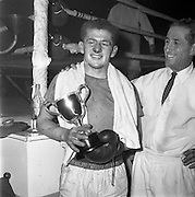 26/01/1962<br /> 01/26/1962<br /> 26 January 1962<br /> Irish Amateur National Junior Boxing Championships at the National Stadium, Dublin. S. Mahon, (Crumlin) Flyweight Junior Champion with cup.