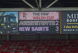 WREXHAM, WALES - Saturday, May 3, 2014: The scoreboard records The New Saints' 3-2 victory over Aberystwyth Town during the Welsh Cup Final at the Racecourse Ground. (Pic by David Rawcliffe/Propaganda)