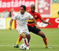 Photo: Chris Ratcliffe.<br /> <br /> Iran v Angola. FIFA World Cup 2006. 21/06/2006.<br /> <br /> Miloy of Angola clashes with Mehdi Mahdavikia of Iran.
