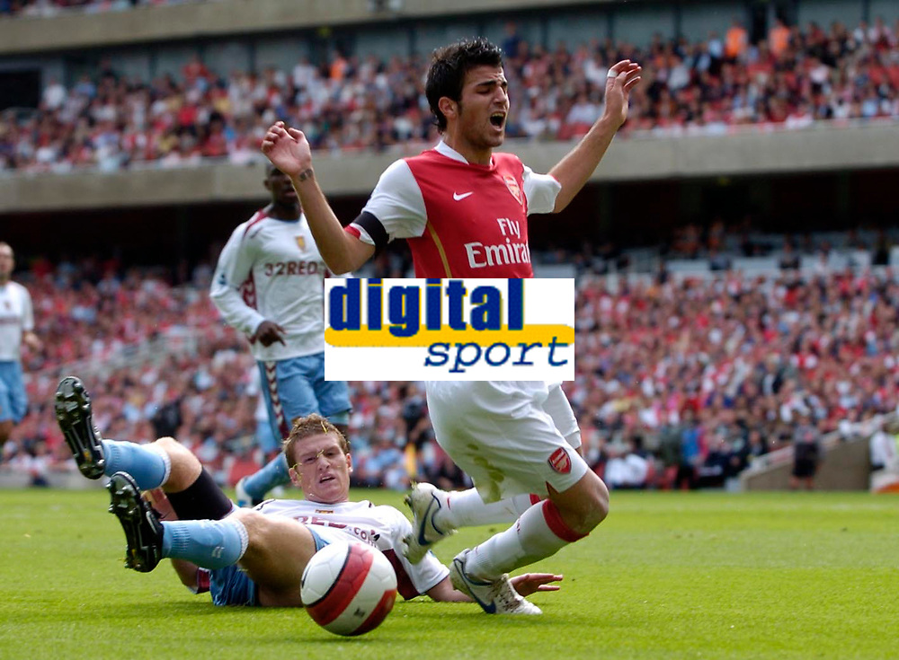 Photo: Daniel Hambury.<br />Arsenal v Aston Villa. The Barclays Premiership. 19/08/2006.<br />Arsenal's Francesc Fabregas is tackled by Villa's Steven Davies.