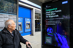 © Licensed to London News Pictures. 09/03/2020. London, UK. A man looks at the Coronavirus public information campaign poster in London, which focuses on hand washing. Three coronavirus victims have died and 278 cases have tested positive for the virus. Photo credit: Dinendra Haria/LNP