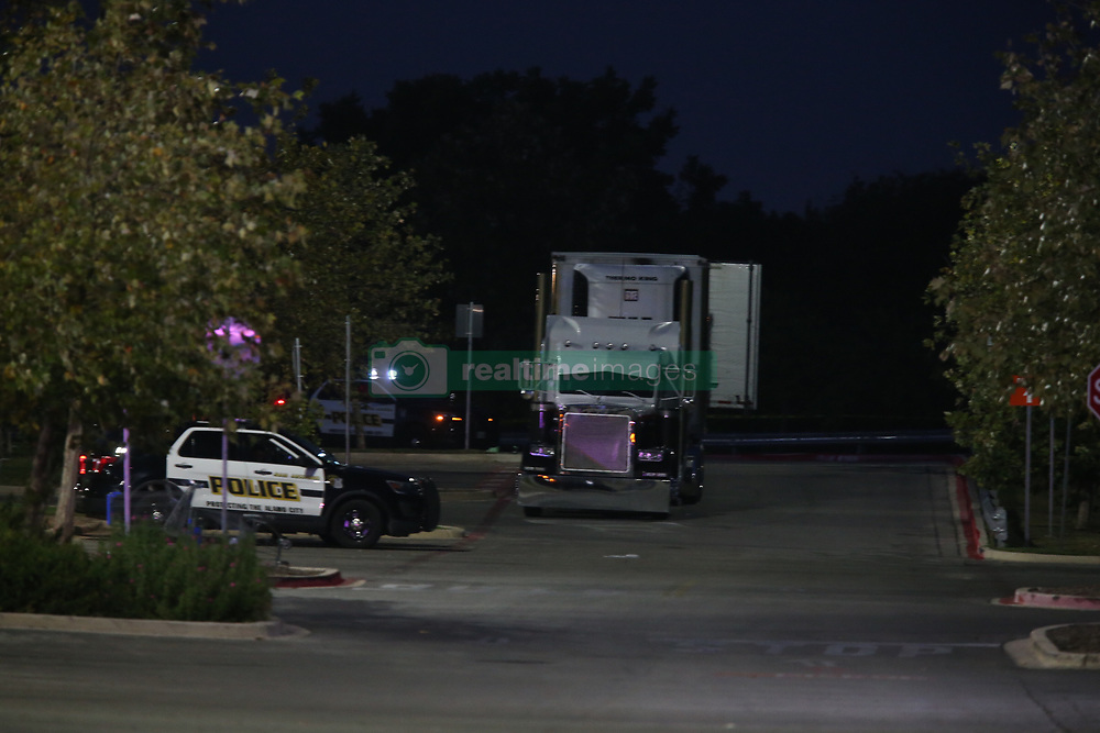 July 23, 2017 - San Antonio, Tx, United States - Law enforcement is at the scene where people were discovered inside a tractor trailer in a Walmart parking lot at IH35 South and Palo Alto Road, Sunday, July 23, 2017. Reports say that 8 were dead be several were in critical condition. (Credit Image: © San Antonio Express-News via ZUMA Wire)