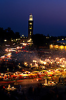 Food stalls in the Jemaa El-Fna (central square) (Mosquee Koutoubia in back), Marrakech, Morocco