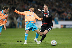 MARSEILLE, FRANCE - Tuesday, December 11, 2007: Liverpool's Harry Kewell and Olympique de Marseille's Karim Ziani during the final UEFA Champions League Group A match at the Stade Velodrome. (Photo by David Rawcliffe/Propaganda)