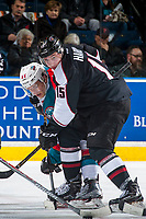KELOWNA, CANADA - MARCH 10: Owen Hardy #15 of the Vancouver Giants checks Calvin Thurkauf #27 of the Kelowna Rockets after the face off during second period on March 10, 2017 at Prospera Place in Kelowna, British Columbia, Canada.  (Photo by Marissa Baecker/Shoot the Breeze)  *** Local Caption ***