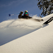 Owen Dudley drives a wave of powder into the air in the backcountry near Mount Baker Ski Area.