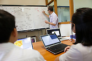 A lecturer draws formulas on a white board, Hanoi, Vietnam, Southeast Asia