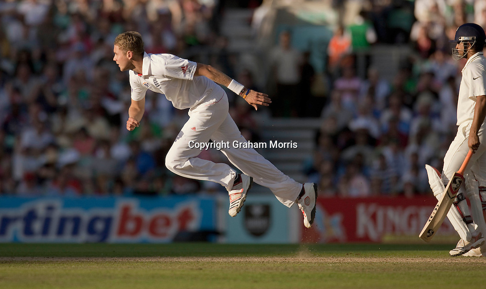 Stuart Broad bowls past Suresh Raina during the fourth and final npower Test Match between England and India at the Oval, London.  Photo: Graham Morris
