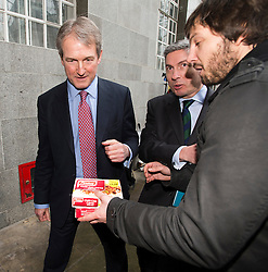© London News Pictures. 09/02/2013 . London, UK.  Secretary of State for Environment, Food and Rural Affairs, OWEN PATERSON being presented with a pack of beef Findus meals by a reporter outside the Department for the Environment, Food and Rural Affairs in London where he met  with representatives of the FSA, as well as food retailers and suppliers, to discuss the unfolding scandal over horsemeat being found in various products.. Photo credit : Ben Cawthra/LNP