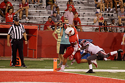 NORMAL, IL - September 01: Jordan Birch avoids one last attempt to keep him out of the end zone during a college football game between the ISU (Illinois State University) Redbirds and the Saint Xavier Cougars on September 01 2018 at Hancock Stadium in Normal, IL. (Photo by Alan Look)