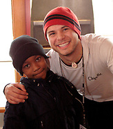 Joe Melendrez (right) pauses for a picture with Anthony Charles, 6 during a burrito party for the homeless hosted by U.D. Religious Studies student Joe Melendrez at Chipotle's on Brown Street in Dayton.