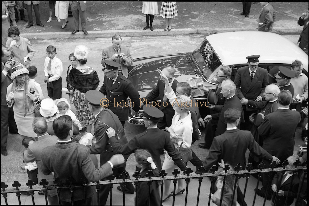 15/06/1961<br /> 06/15/1961<br /> 15 June 1961<br /> <br /> A Royal Visit to Ireland by Princess Grace and Prince Rainier of Monaco. The royal couple at Westport, Co. Mayo were surrounded by guards.