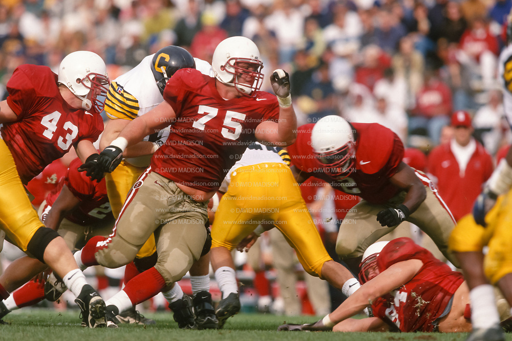 COLLEGE FOOTBALL:  Stanford vs Cal in the 100th annual Big Game on November 22, 1997 at Stanford Stadium in Palo Alto, California.  Carl Hansen #75, Jon Haskins #43.  Photograph by David Madison ( www.davidmadison.com ).