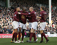 Photo: Lee Earle.<br /> Fulham v Arsenal. The Barclays Premiership. 04/03/2006. Thierry Henry (L) is congratulated by team mates after scoring the opening goal.