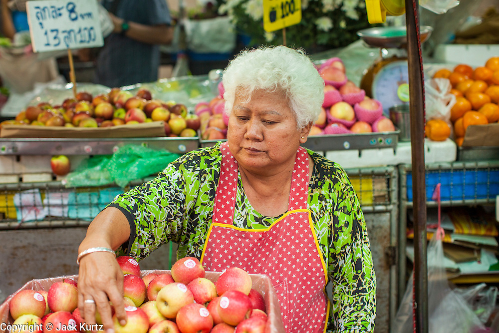 22 OCTOBER 2012 - HAT YAI, THAILAND:   A woman sells imported apples in the market in Hat Yai. Hat Yai is the largest city in southern Thailand. It is an important commercial center and tourist destination. It is especially popular with Malaysian, Singaporean and Chinese tourists.     PHOTO BY JACK KURTZ