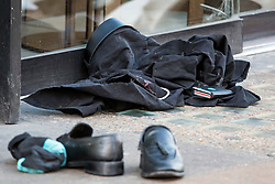 © Licensed to London News Pictures. 17/02/2019. London, UK. A wallet lies on blood covered trousers at the scene on Oxford Street in central London where three people were stabbed last night. The incident took place near Tape Nightclub. Photo credit: Ben Cawthra/LNP
