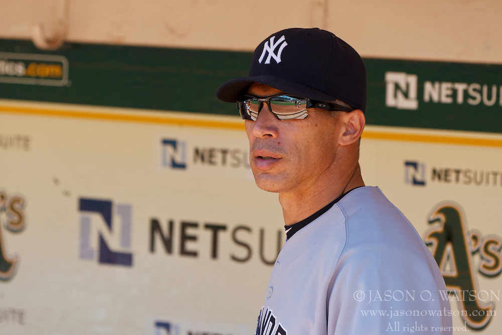 OAKLAND, CA - JULY 22: Joe Girardi #28 of the New York Yankees stands in the dugout before the game against the Oakland Athletics at O.co Coliseum on July 22, 2012 in Oakland, California.  The Oakland Athletics defeated the New York Yankees 5-4 in 12 innings. (Photo by Jason O. Watson/Getty Images) *** Local Caption *** Joe Girardi