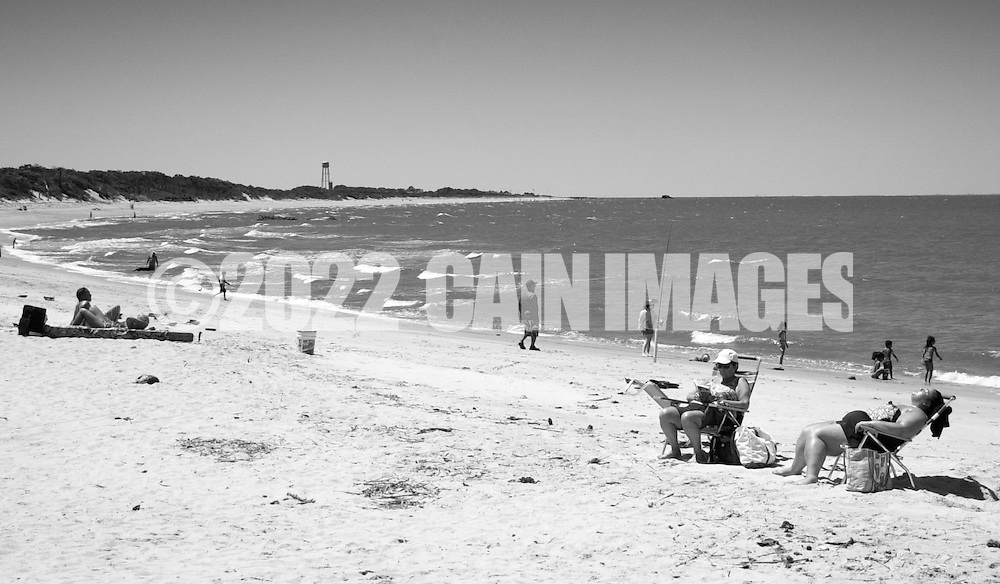 Sunbathers set up their chairs and blankets Saturday July 2, 2016 at Higbee Beach in Cape May, New Jersey. Photo by William Thomas Cain/Cain Images